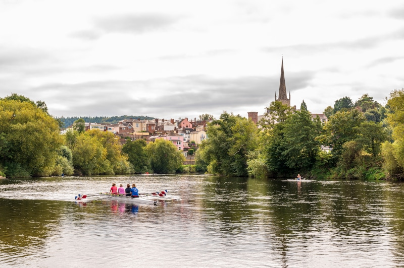 Rowers on the River Wye, looking across to Herefordshire town and St Mary's Church, Ross on Wye, Herefordshire