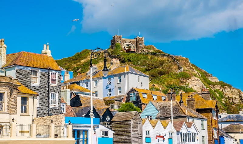 Hasting Castle including houses in Old Town upon the hill and funicular railway in summer