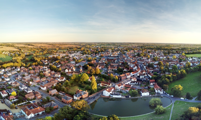 Aerial view of Great Dunmow and surrounding countryside during sunset on a summers day.