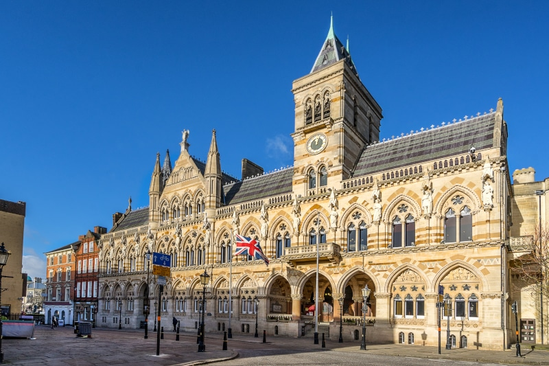 Northampton Guildhall lit up in sunshine on a quiet summers morning with blue skies.